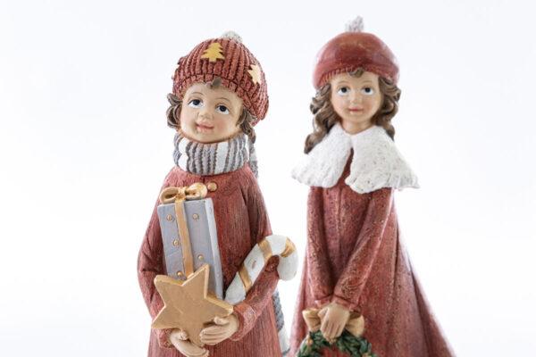 Coppia bimbi in resina con regali natalizi